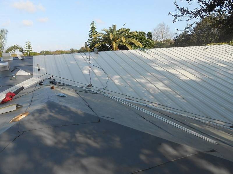 standing-seam-metal-roof-white-in-progress