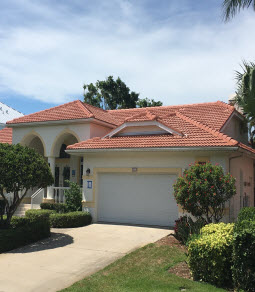 Florida home with a newly replaced orange tile roof